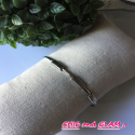 Bracelet a/adj  jonc sculpte fleche ZAG