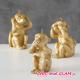 Bougies 3 singes cire dorée Boltze