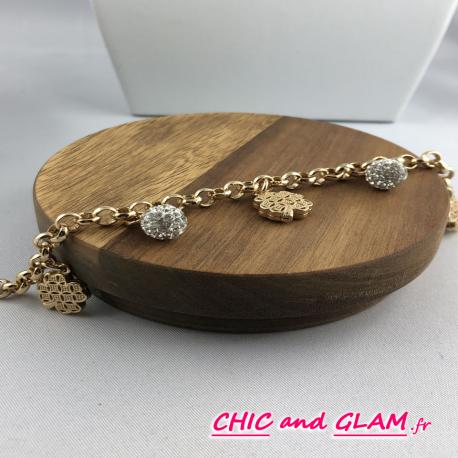 Bracelet chaine métal doré brillant treffle et strass
