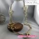 Sautoir metal dore formes enlacées Dolce Vita