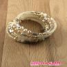 Bracelet spirale perles et cristaux ton rose beige