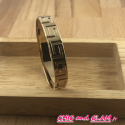 Jonc plat sculpté métal doré 6.5/1 cm